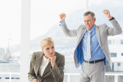 Furious boss yelling at colleague Stock Image