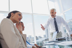 Furious boss yelling at colleagues Stock Images