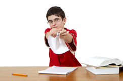 Furious boy. The furious boy tears out pages from the book Royalty Free Stock Image