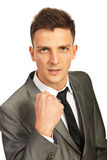 Furious business man showing fist stock photos