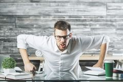 Furious business man at workplace. Portrait of furious young business man at workplace. Stress, problem concept Royalty Free Stock Photography