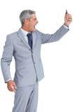 Furious businessman answering phone Stock Photos