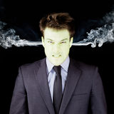Furious businessman getting green face Royalty Free Stock Images
