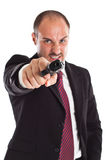 Furious businessman with a gun Royalty Free Stock Photo