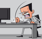 Furious businessman hitting the computer keyboard Royalty Free Stock Photo