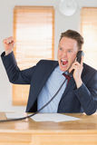 Furious businessman outraged on the phone Stock Image