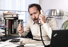 Furious Businessman on the phone Stock Photography