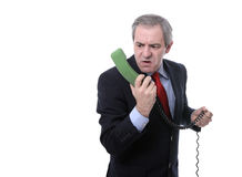 Furious businessman on the phone Stock Photos