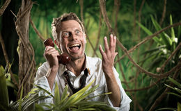 Furious businessman on the phone lost in the jungle Stock Images