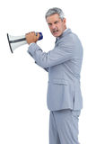 Furious businessman posing with loudspeaker Stock Photography