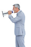Furious businessman shouting in loudspeaker Royalty Free Stock Image