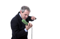 Furious businessman shouting on the phone. Isolated on white Royalty Free Stock Photography
