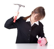 Furious businesswoman and piggy bank Royalty Free Stock Photo