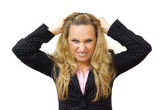 Furious businesswoman pulling hair Royalty Free Stock Images