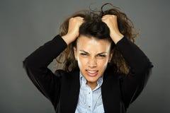 Furious businesswoman pulling her hair Stock Photos