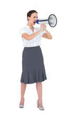 Furious businesswoman shouting in her megaphone Royalty Free Stock Images