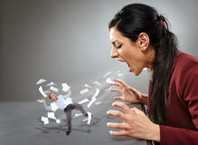 Furious businesswoman shouting at a subordinate Stock Images