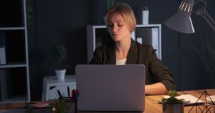 Furious businesswoman throwing notepad at office desk. Furious businesswoman throwing notepad on desk after receiving negative news on office laptop stock video