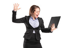 Furious businesswoman yelling at a laptop Stock Photography