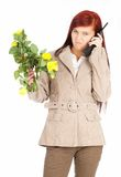 Furious calling young woman with flowers Stock Photography