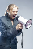 Furious Caucasian Blond Female in Suite Shouting Using Megaphone Stock Photos