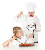 Furious chef with megaphone and cook Royalty Free Stock Photography