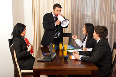 Furious chief  shouting in megaphone. Furious chief shouting in megaphone to his employees at meeting Stock Photography