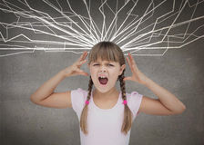 Furious child. Screaming on grey background royalty free stock images