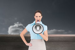 Furious classy businesswoman talking in megaphone Stock Photo