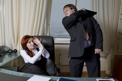 Furious clerk beats boss. Office people. Royalty Free Stock Images
