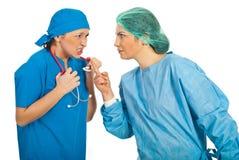 Furious doctors women argue stock image
