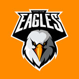 Furious eagle head athletic club vector logo concept isolated on orange background.  Stock Photography