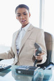 Furious elegant businesswoman hanging up the phone Stock Image