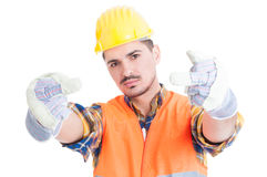 Furious engineer or constructor showing double rude gesture. As aggressive attitude concept isolated on white Stock Photos