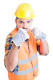 Furious engineer showing his fists and standing in fighting posi Stock Photography