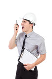 Furious engineer using walkie talkie. Stock Photography