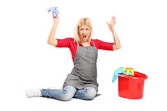 Furious female cleaner gesturing anger. Isolated on white background Stock Photo