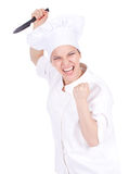 Furious female cook keeping knife Royalty Free Stock Photo