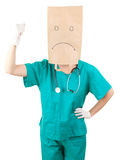 Furious female doctor with paper bag on head Stock Images