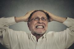 Furious frustrated elderly man having hard day Royalty Free Stock Photos