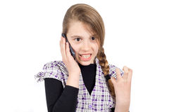 Furious Girl Expressing Anger Because of Unpleasant Phone Call. Furious Girl With Clenched Left Hand Expressing Anger Because of Unpleasant Phone Call. Half Royalty Free Stock Images
