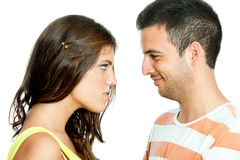 Furious girl looking at boyfriend. Royalty Free Stock Images