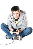 Furious guy with a joystick for game console. Isolated Royalty Free Stock Photography