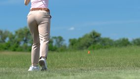 Furious with her miss girl throwing golf club to grass, failed attempt, loser. Stock footage stock video footage