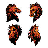 Furious horse head heraldic icons set. In fire shape. Raging stallion vector heraldry emblems. Mustang shield symbol for sport club emblem, team badge, label Royalty Free Stock Photography
