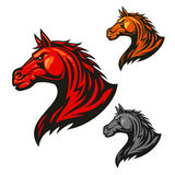 Furious horse icons. Stylized stallion emblems. Furious horse head icon. Stylized fire flaming stallion vector emblems. Aggressive powerful mustang symbol for Royalty Free Stock Photos