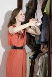 Furious jealous woman want to cut shirt-sleeve Royalty Free Stock Photos