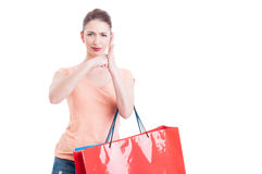 Furious lady holding shopping bags hitting fist in palm gesture Royalty Free Stock Image