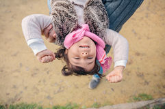 Furious little girl trying escape of father hands Stock Photography