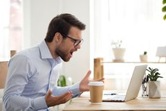 Free Furious Male Employee Have Laptop Problems While Working Stock Photo - 133854120